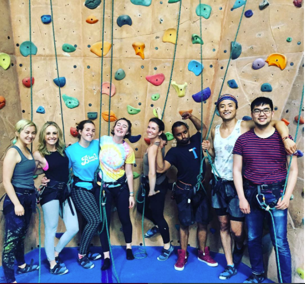 employees rockclimbing together.png