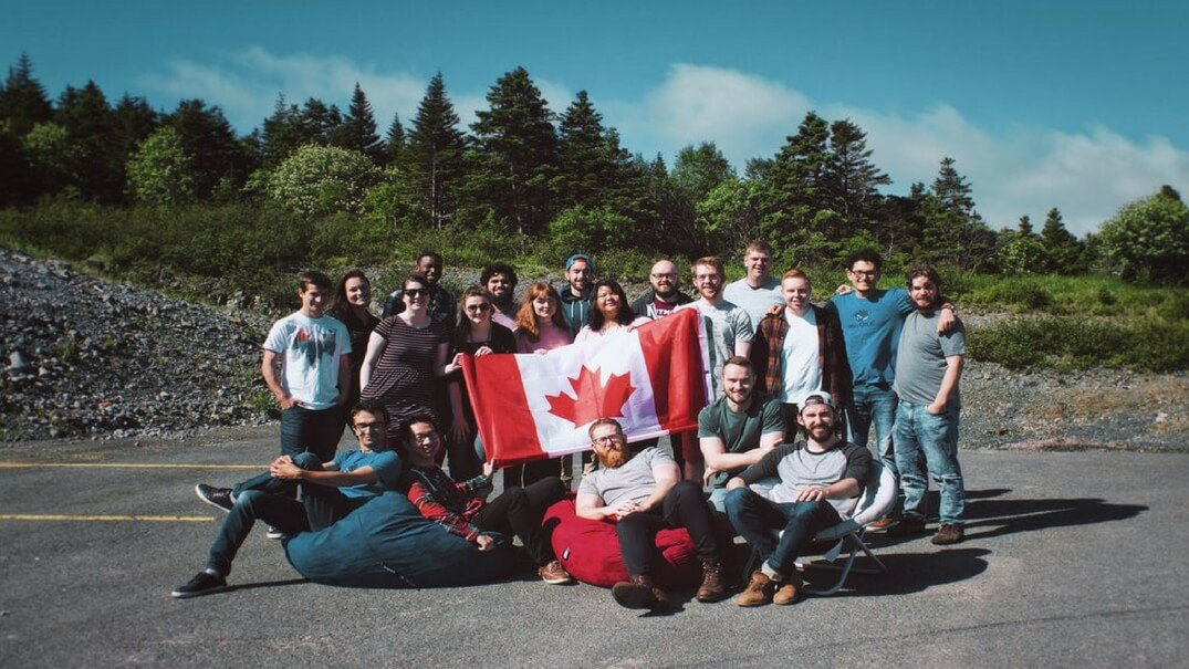 The HeyOrca team holding a Canadian flag together